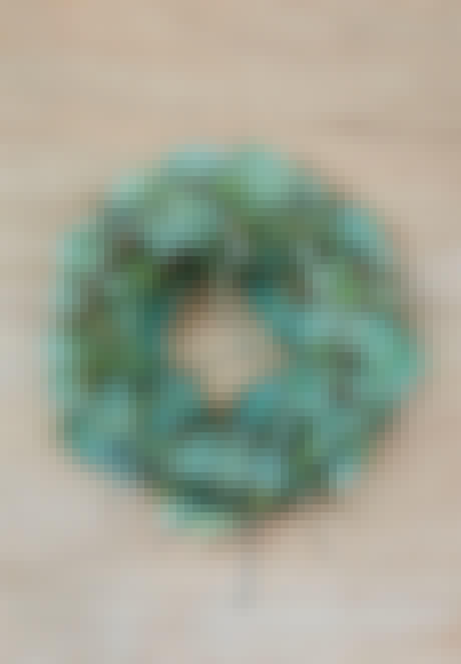 Grøn dørkrans med husløg