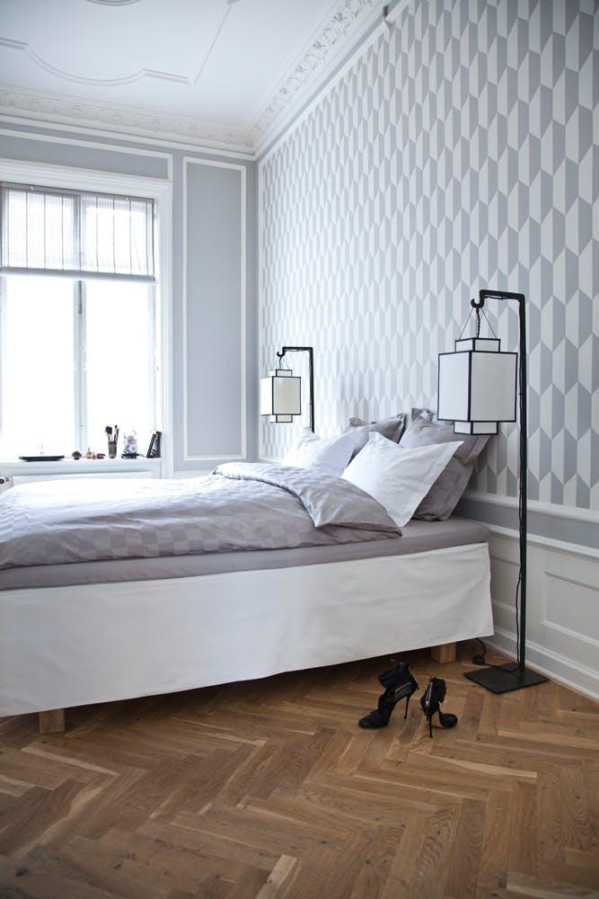 Væggenes mønster gentages i sengetøjet