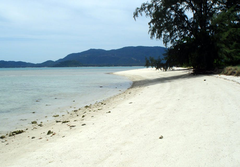 Egen strand i Thailand