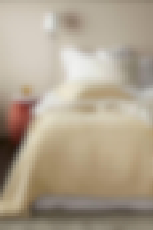sengetæppe pastel gul sovesærelse