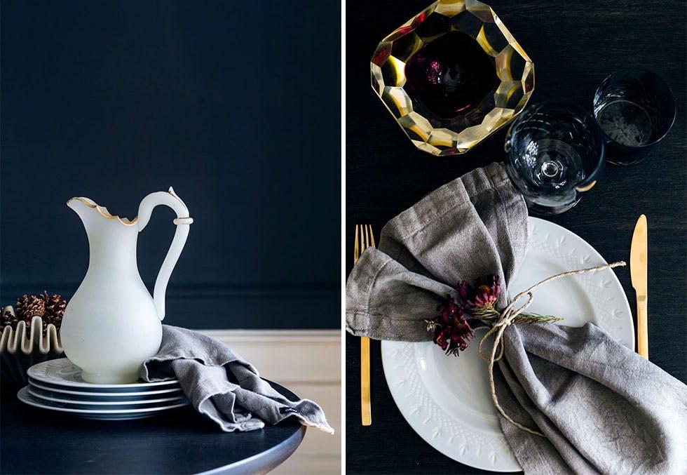 Bord med gullbestikk og linservietter.