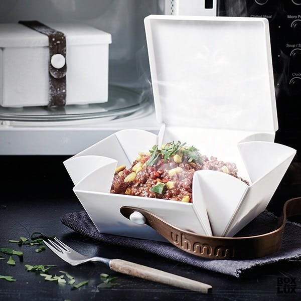 bæredygtig madkasse der foldes ud til en tallerken