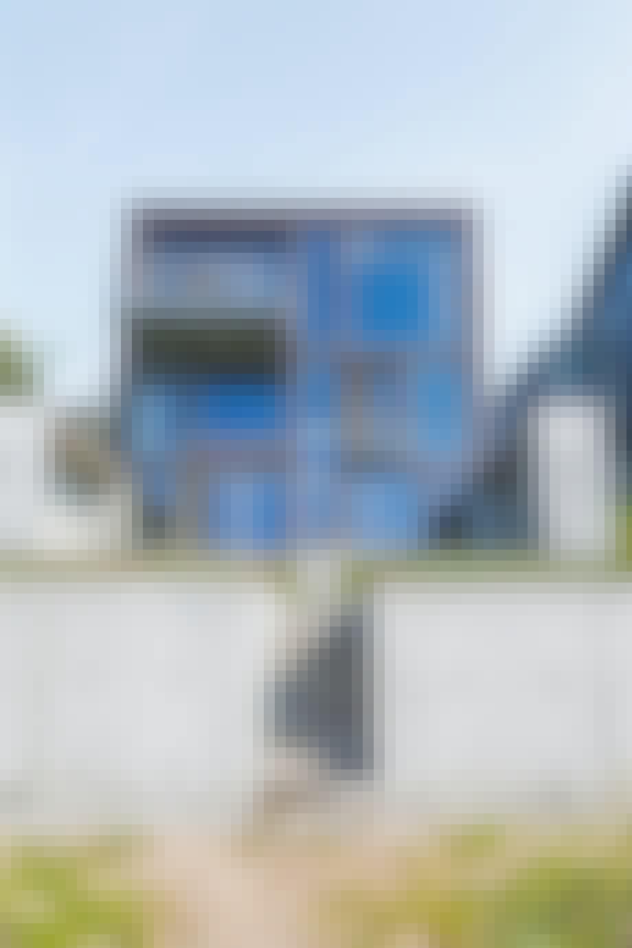 Arkitekttegnet hus teglsten beton Flensborg Fjord tre etager