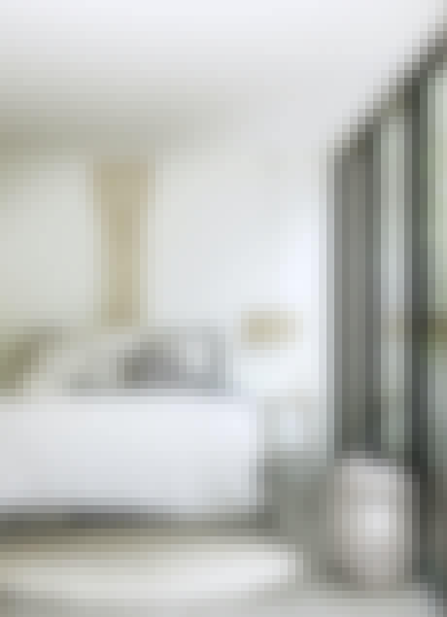 Soveværelse med drømmefanger og rundt gulvtæppe