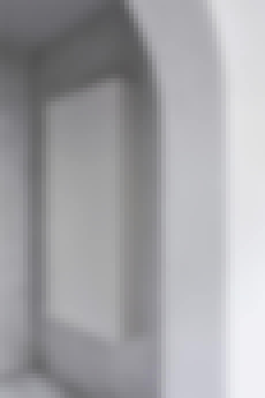 Et hvidt skab, der er designet af Matrikula Studio