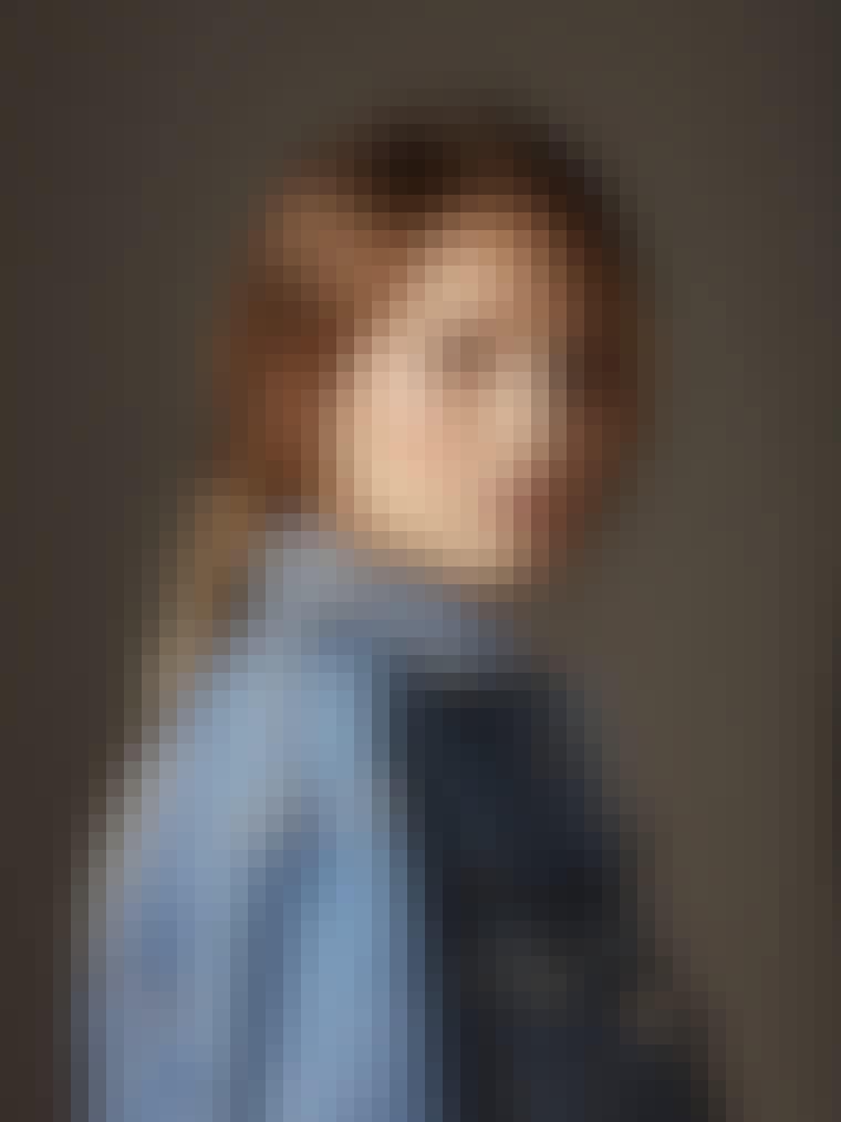 Portrait of beautiful and stylish woman wearing denim jacket