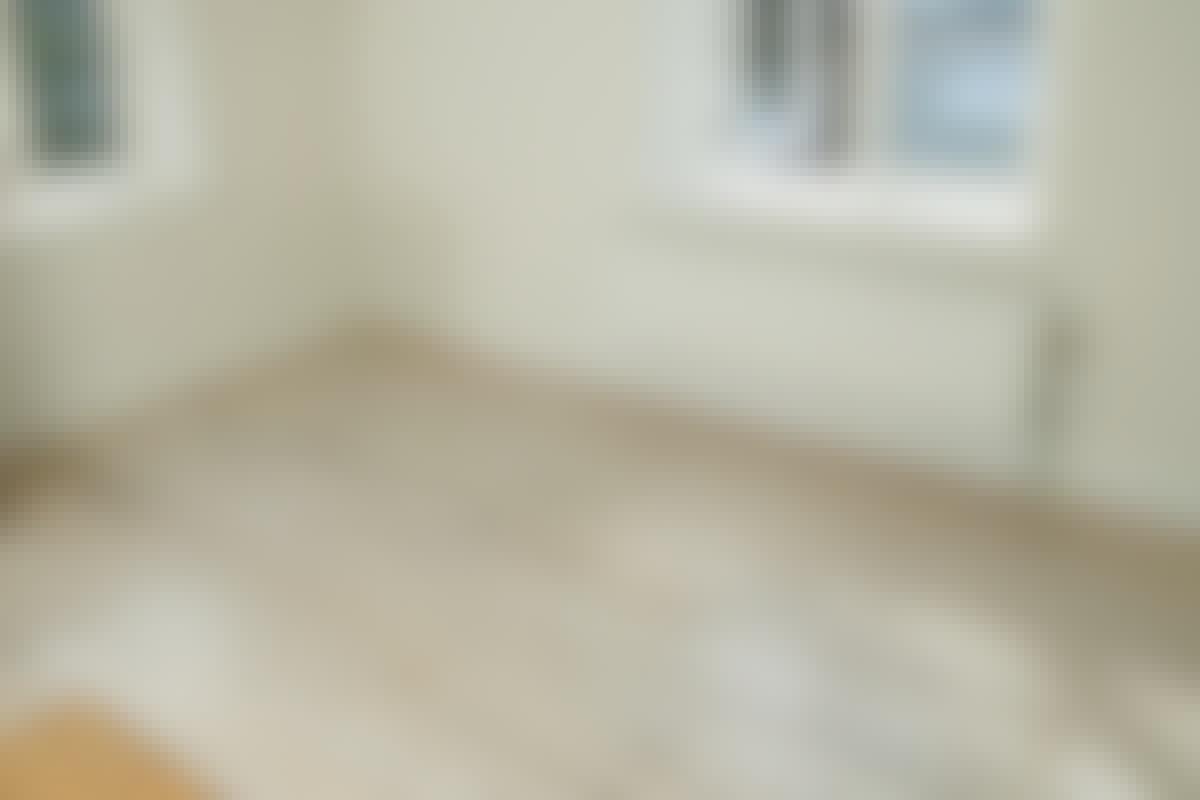 _**Før.**_ Det gamle kjøkkengulvet er nedslitt og trist å se på.