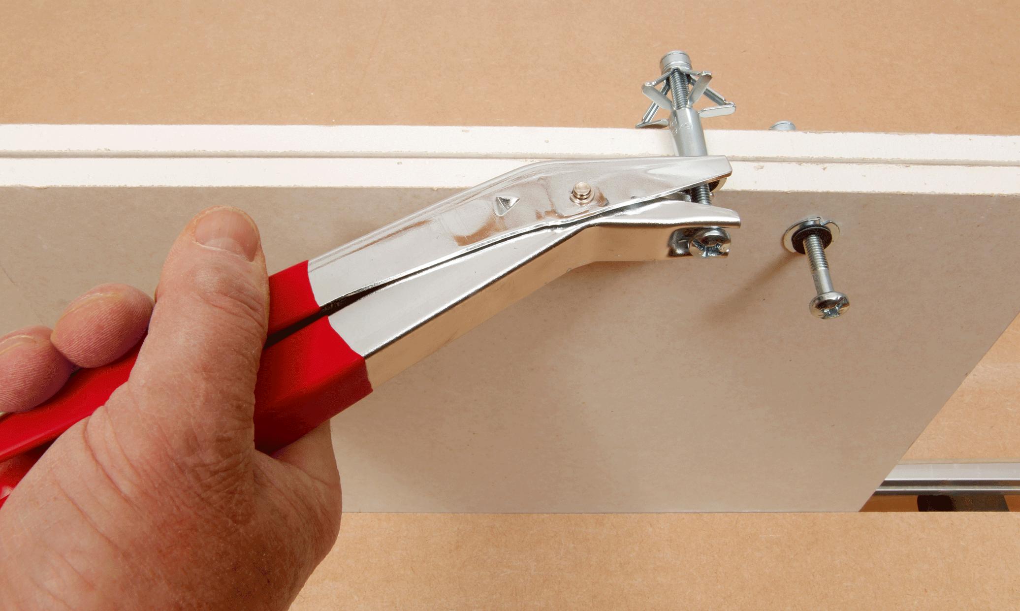 Hvordan henge opp bilder og tunge gjenstander i gipsveggen
