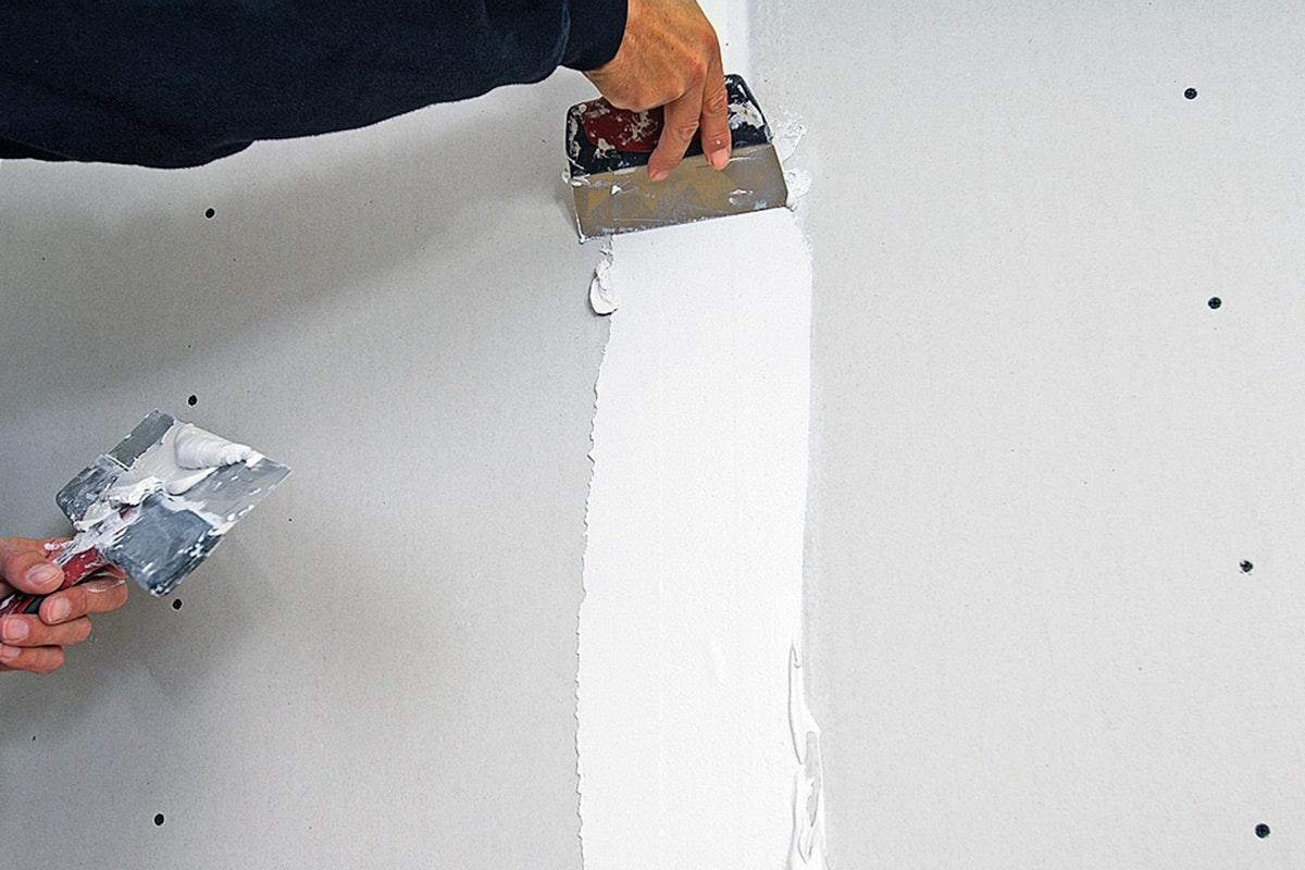 sätta gipsskivor på vägg