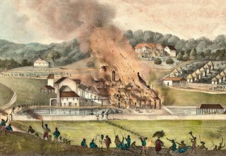 Plantage sätts i brand av slavar under upproret på Jamaica 1832.