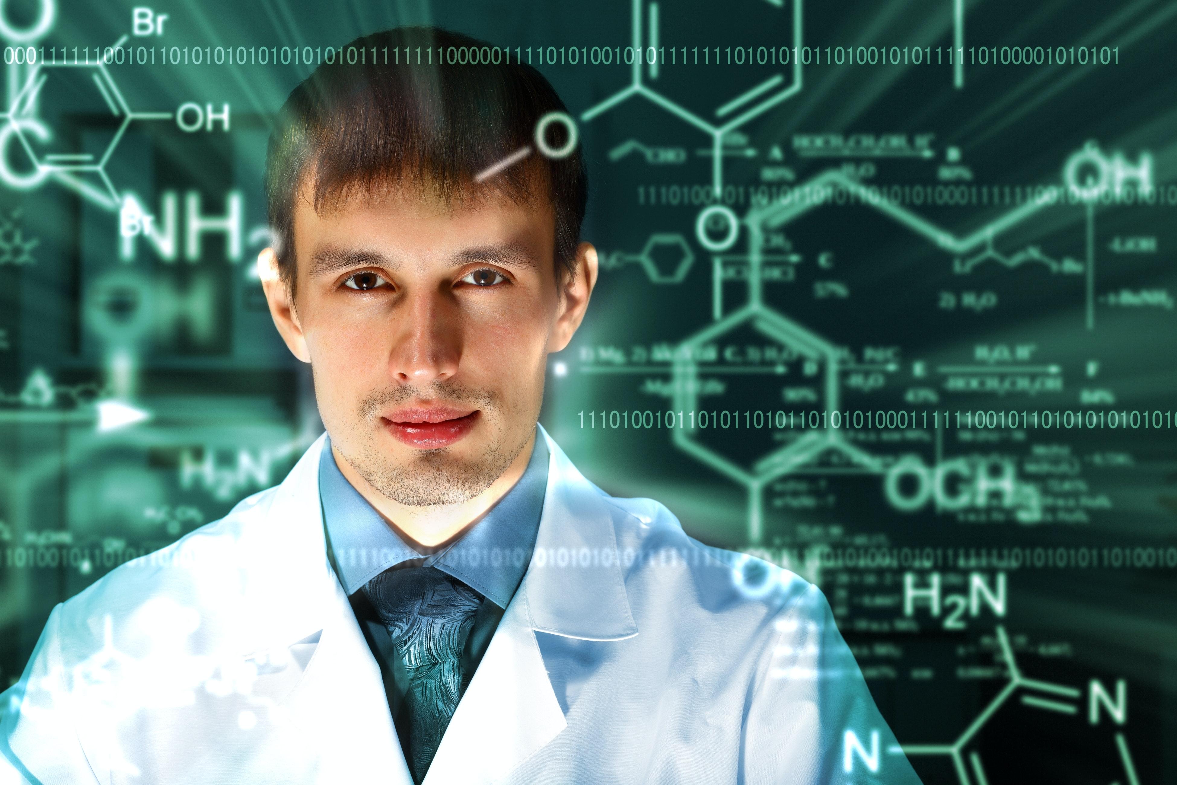 Ung forsker i hvid kittel