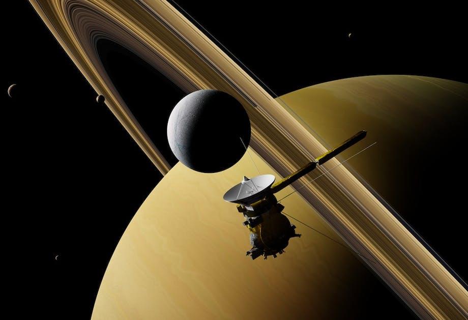 Saturnus med rymdsond och måna