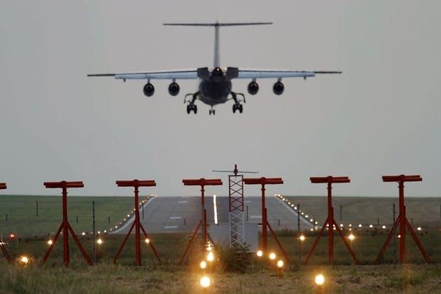 Airplane landing on a runway