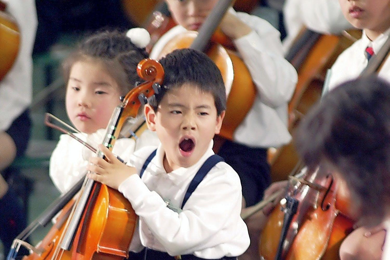 Kid yawning at concert