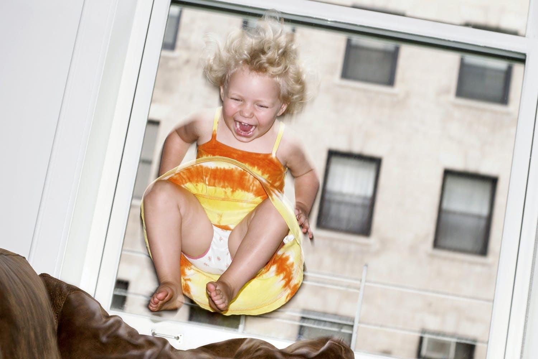 Child jumping on sofa